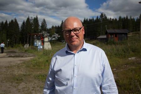 FORNØYD: Styreleder i Varingskollen Alpinsenter har all grunn til å smile. Her fra da skianlegget ble kjørt i fjor sommer. Foto: Anders Holtet