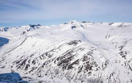De to anbefalte variantene på dag 4. Ruta over Galdhøpiggen 2468 moh er fantastisk, men kan bli vel drøy for bein som allerede har gått mange høydemeter. Det blå alternativet anbefales for de som er i tvil. Foto: Marte Stensland Jørgensen / Høgruta i Jotunheimen.