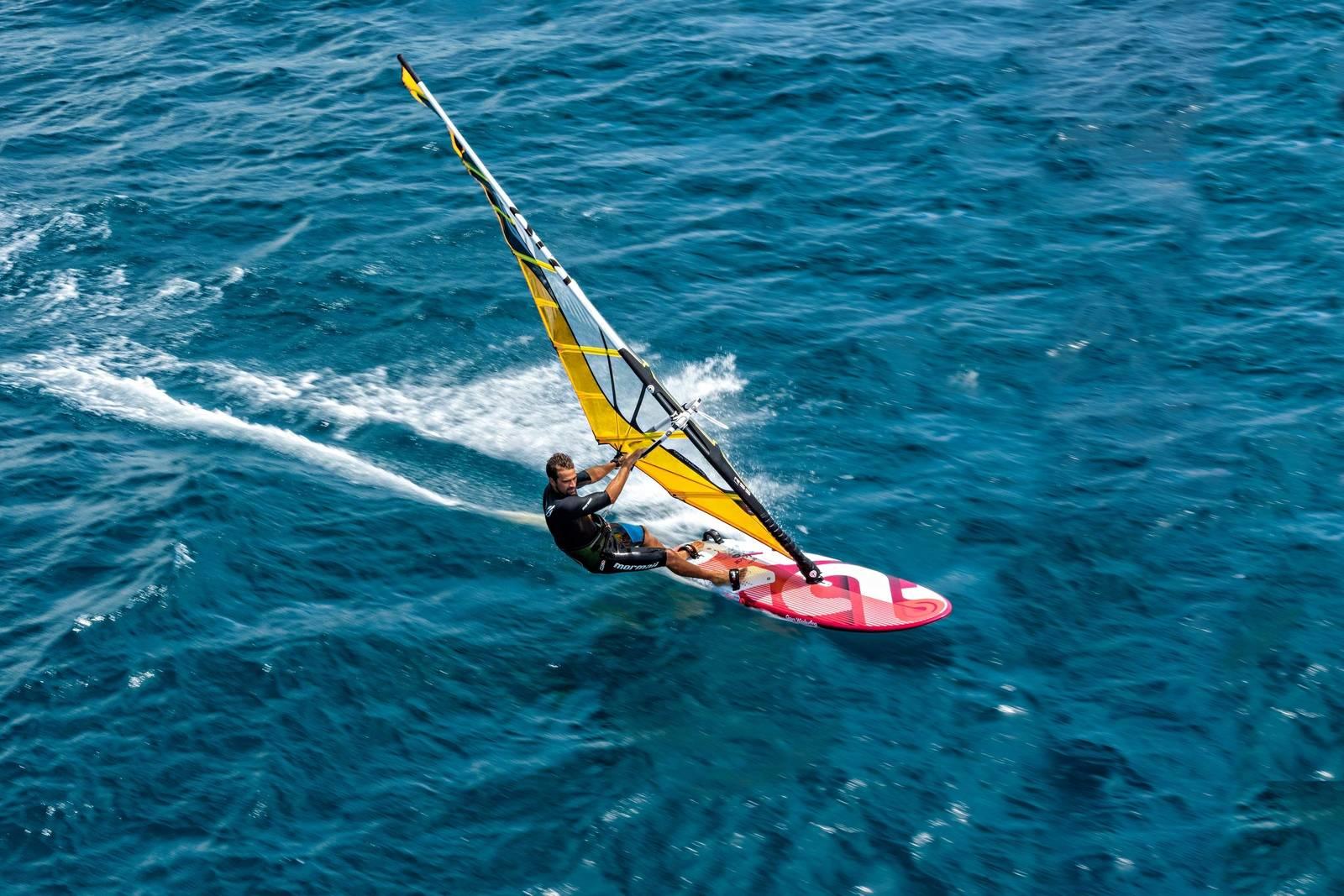 Plane windsurfing